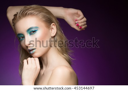 Aqua princess. Closeup shot of a stunning futuristic fashion model wearing creative metallic blue makeup looking to the camera copyspace on the side