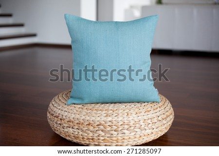 Aquamarine blue pillow in white interior