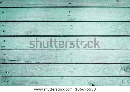 Aquamarine wooden background texture with faded parallel vintage wood planks with two haphazard rows of small nails in the 2014 fashion color palette - stock photo