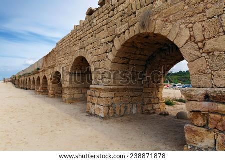 Aqueduct in ancient Caesarea - stock photo