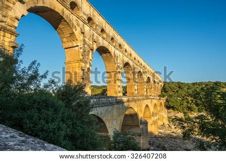 Aqueduct Pont du Gard over Gardon river - France - stock photo