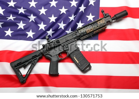 AR-15 (M4A1) custom carbine on the flag of USA