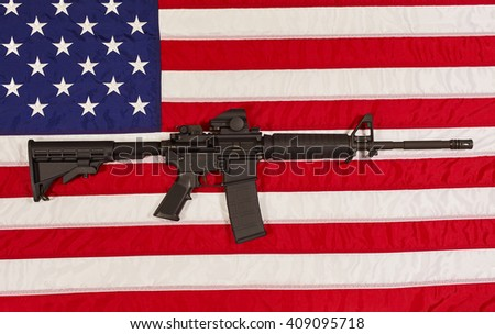AR15 M4A1 M16 Style Weapon Automatic Rifle with USA Flag concept freedom justice patriotism - stock photo