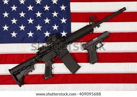 AR15 M4A1 Style Weapon Automatic Rifle and Pistol on USA Flag concept freedom and justice - stock photo