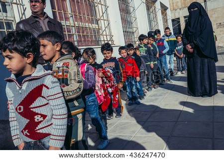 Ar Ramtha, Jordan - December 23, 2015. Students and teachers of primary school for Jordanians and Syrian refugees in Ar Ramtha city