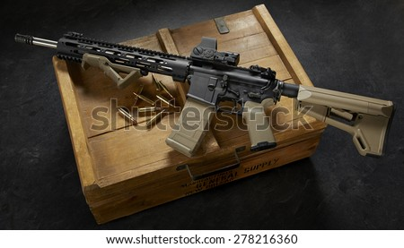 ar15 rifle on wood crate - stock photo