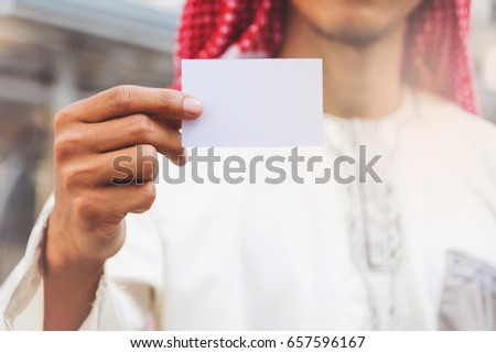 Arab Businessman hand showing business card