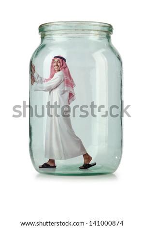 Arab businessman in glass jar - stock photo