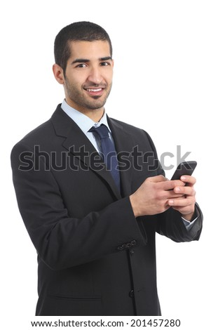 Arab businessman using a smartphone and looking at camera isolated on a white background - stock photo