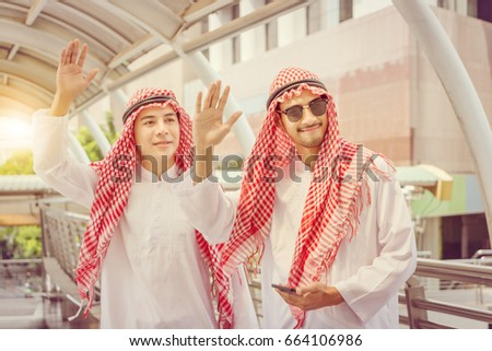 Arab businessman waving greetings hands together stock photo arab businessman waving greetings hands together at walkway area m4hsunfo