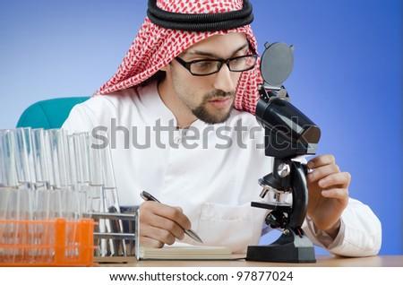 Arab chemist working in lab - stock photo