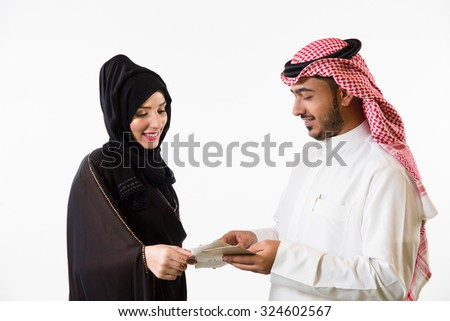 Arab couple looking at fabric swatches
