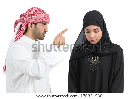 Arab couple with a man arguing to his wife isolated on a white background            - stock photo
