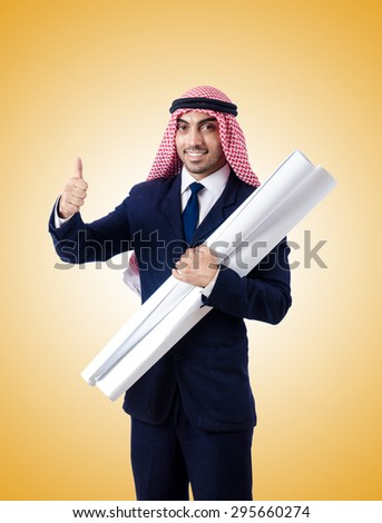 Arab engineer with drawings against gradient  - stock photo