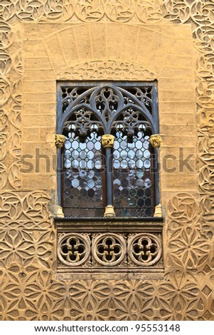 Arab floral wall decoration and window, Segovia; Spain - stock photo