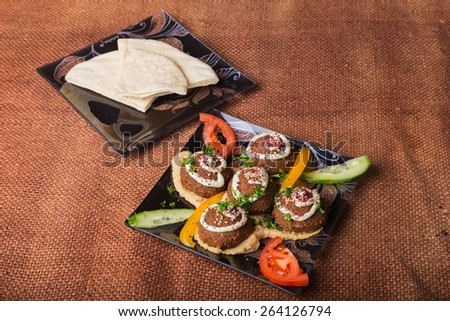 Arab food. Meat balls. Meatballs with bread. Meatballs with vegetables. - stock photo