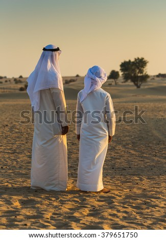Arab in the Arabian desert on a hot sunny day - stock photo