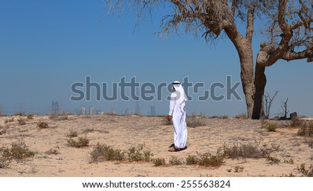 Arab man in desert - stock photo