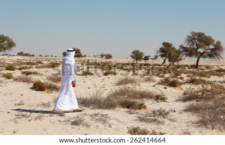 Arab man in desert - stock photo