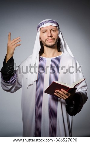 Arab man with book in diversity concept - stock photo