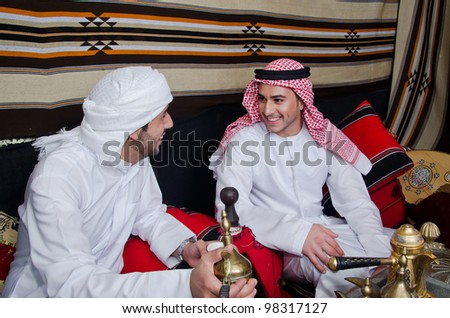 Arab men setting in traditional tent