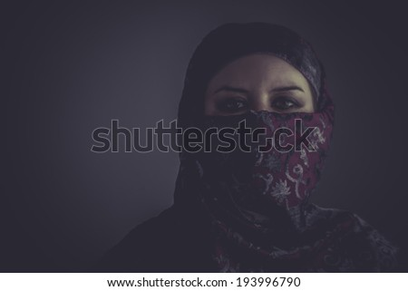 Arab mysterious woman with purple lace veil - stock photo