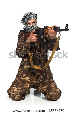 Arab nationality in camouflage suit and keffiyeh with automatic gun on