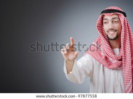 Arab pushing virtual buttons - stock photo