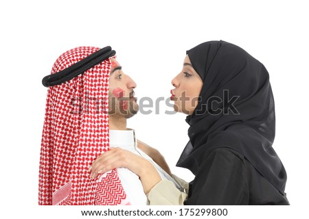 Arab saudi obsessed woman kissing desperately a man isolated on a white background           - stock photo