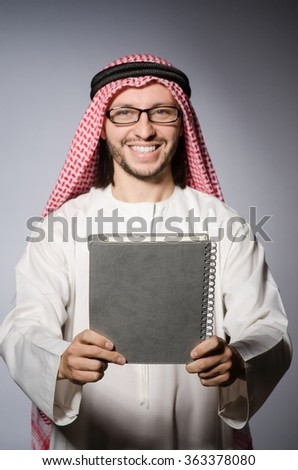 Arab student with book in education concept - stock photo