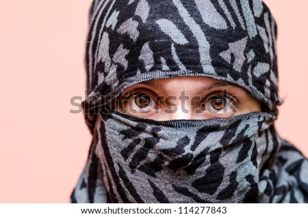 Arab woman covered in a burqa shows his eyes