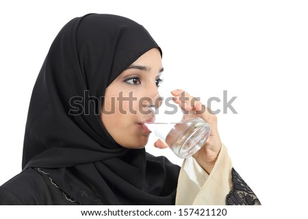 Arab woman drinking water from a glass isolated on a white background - stock photo