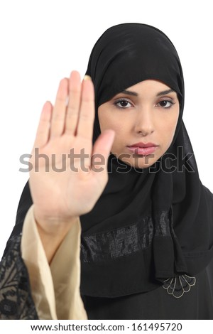 Arab woman making stop gesture with her hand isolated on a white background