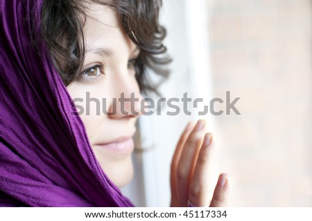 Arab woman with purple headscarf.