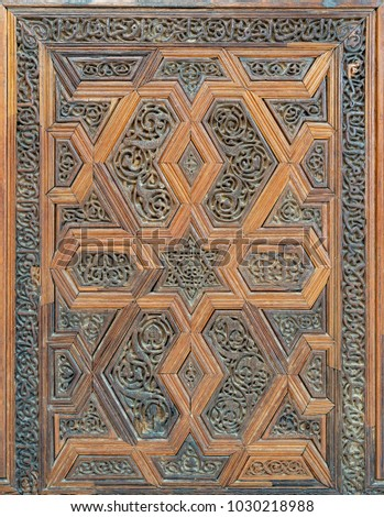 Arabesque floral engraved patterns of wooden ornate door leaf, Cairo, Egypt