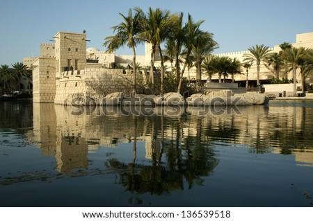 Arabian architecture of a luxurious hotel in Dubai, UAE-- Dubai Madinat Jumeira - stock photo