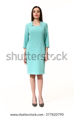 arabian asian eastern brunette business executive woman with straight hair style in blue aquamarine party cocktail drink dress high heels shoes stand full body length isolated on white