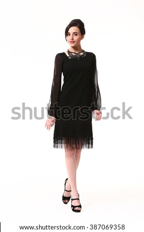 arabian asian eastern brunette business executive woman with straight hair style in formal black cocktail party laces  long sleeve dress high heel shoes standing full body length isolated on white - stock photo