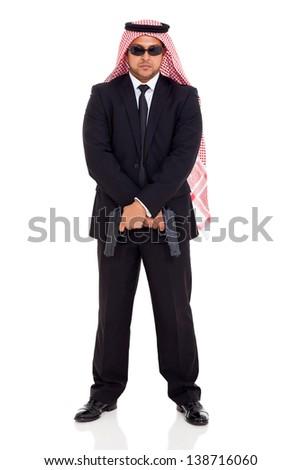 arabian bodyguard holding two handguns - stock photo