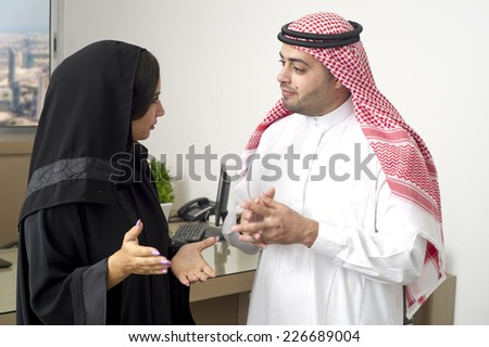 Arabian Business man having a discussion with an arabian businesswoman in the office