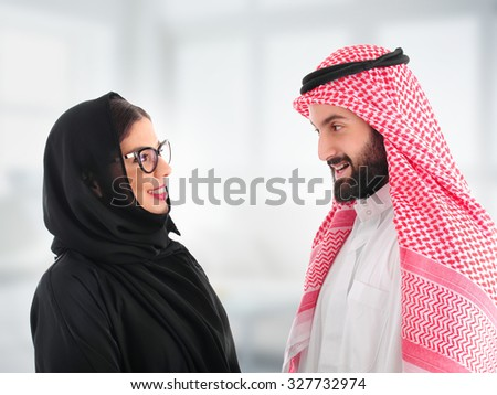 Arabian Business man having a discussion with an arabian businesswoman in the office - stock photo