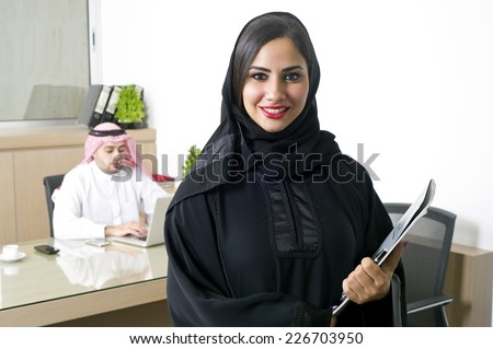 Arabian Businesswoman with her boss in the Background  - stock photo