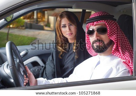 arabian couple in a newely purchased car enjoying life - stock photo