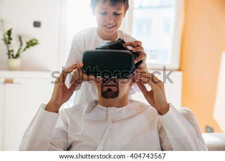 Arabian Father And Son Using VR Headset At Home