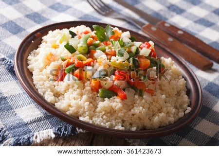Arabian Food: Cous Cous with vegetables close-up on a plate. horizontal