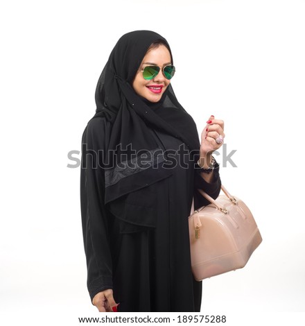 Arabian girl with hijab holding handbag isolated on white  - stock photo