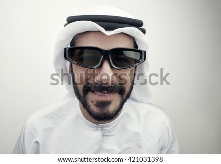 Arabian guy wearing 3d glasses , - stock photo