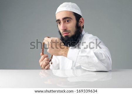 Arabian religious muslim man holding a rosemary - stock photo