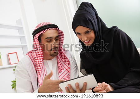 Arabian young couple using tablet