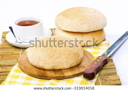 arabic bread and cup of tea on isolated background - stock photo